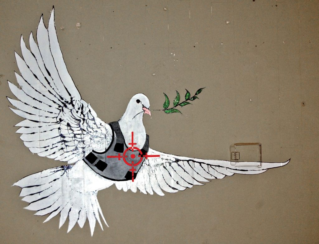 banksy armored dove of peace